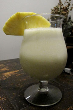 Pina colada, with pineapple wedge