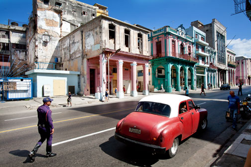 A policeman approaches a car in Central Havana, Cuba.