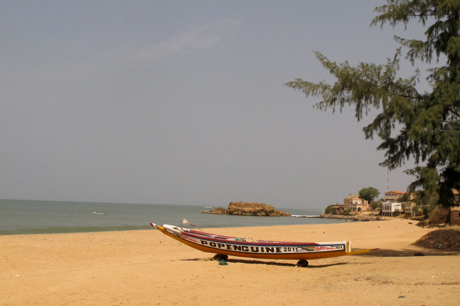 Pirogue on a beach in Popenguine, Senegal