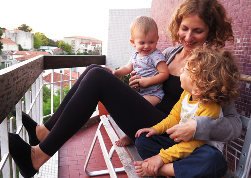 Two kids and mom on a terrace in Portugal, Europe