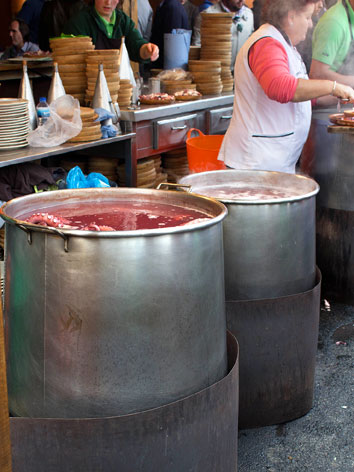 Cauldrons of polbo (octopus) at a market in Galicia, Spain
