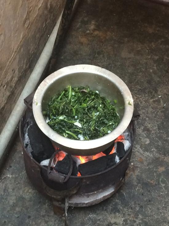 Cooking spinach in coconut milk in Zanzibar