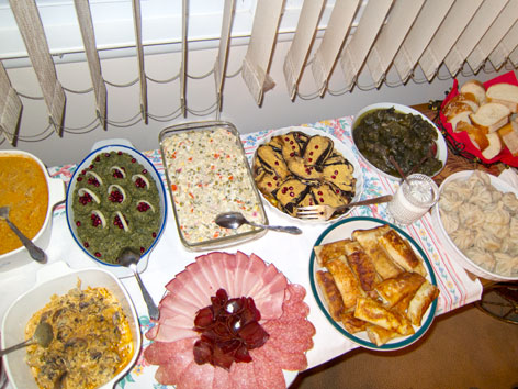 A table spread with homecooked Georgian food