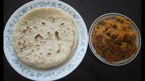 Round balep korkun, a flatbread from Tibet, pictured with a veg curry.
