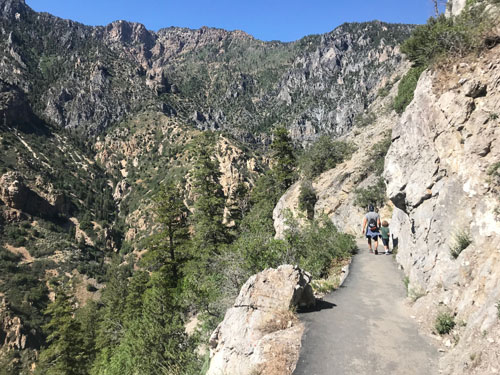 Hiking up to Timpanogos Cave National Monument in Utah with kids.