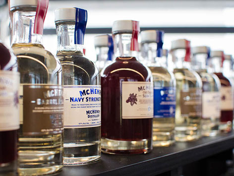 A shelf display of local Tasmanian whiskies and gin in Hobart.