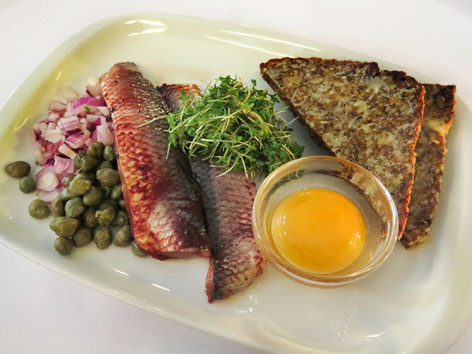 Marinated herring with egg yolk from Copenhagen, Denmark