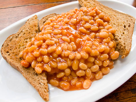 A plate of beans on toast from Greenfields Sandwich Emporium & Café in London, England.