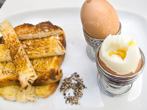 Boiled eggs and soldiers, or sliced toast, from a London cafe, England