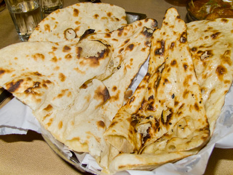 One of many wonderful Indian breads in New Delhi, India: a basket of fresh naan.