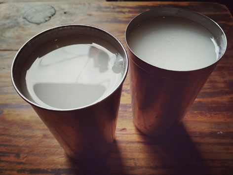 Two cups of chhaang, an alcoholic fermented beverage in Nepal, from a Kathmandu eatery.
