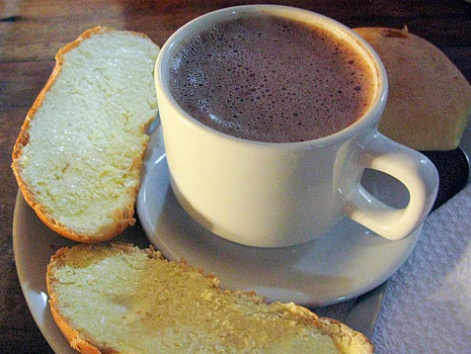 A mug of chocolate santafereño with toast from La Puerta Falsa in Bogota, Colombia.