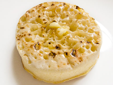 A buttered, toasted crumpet, from London, England