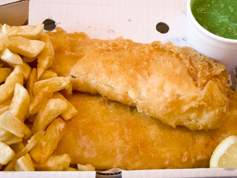 Fish and chips and mushy peas from a chippy takeout in St. Albans, near London, England