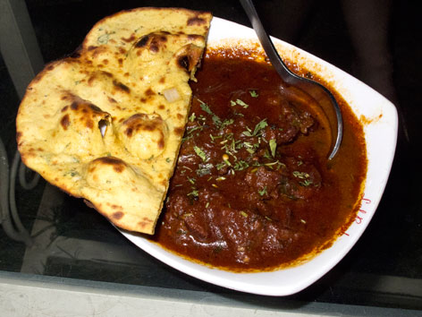 A plate of laal maans and missi roti from Lal Bagh in Udaipur, India.