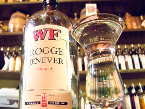A bottle and glass of local jenever from Proeflokaal Wynand Fockink in Amsterdam.