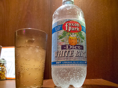A bottle and cup of Foxon Park white birch soda, from New Haven, Connecticut