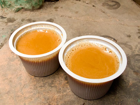 Two cups of masala chai from an Old Delhi tea stall in Delhi, India.