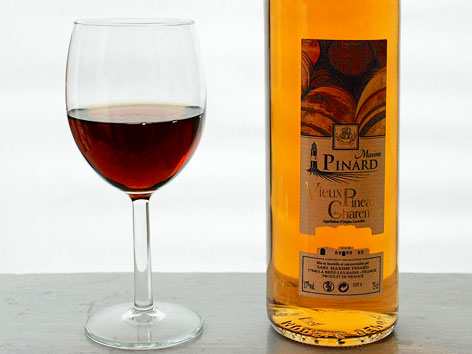 A bottle and glass of pineau from Maxime Pinard in Charente-Maritime.