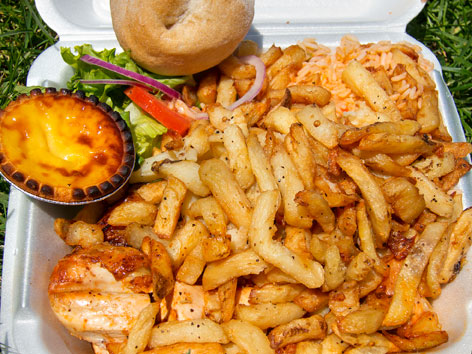 Portuguese chicken, fries, salad, and egg tart from Romados in Montreal, Quebec