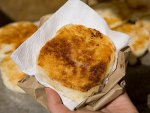A delicious arepa con queso on the street in Cartagena, Colombia.