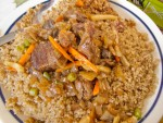 A plate of ceebu yapp, or rice and lamb, from a rice shack in Dakar, Senegal
