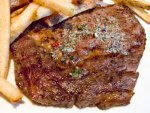 The Delmonico steak with fries from New York City's Delmonico's Restaurant.