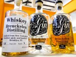 Bottles of whiskey and gin distilled in Brooklyn, NY, at Breukelen Distilling