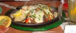 Queso a la Parrila with Beef and Chicken Fajitas